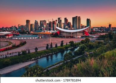 A colorful sunrise sky over downtown Calgary in the summer