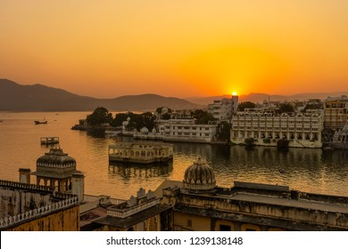 Colorful sunset above architecture and lake water in Udaipur, Rajasthan, India. Udaipur is one of the most visited tourist destinations in India.