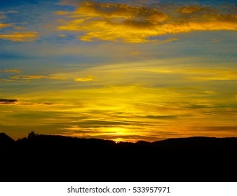 Colorful sunset in alsacien mountains near Mont Sainte-Odile, France