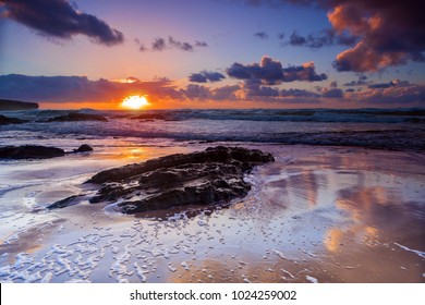 Colorful sunset at Amoreira beach near Aljesur town, Portugal.