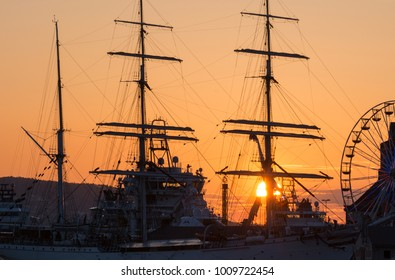 Colorful sunset at Bergen bryggen with big ship , Norway.