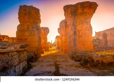 Colorful sunset in Carthage. Baths of Antonius in Carthage, near Tunis, Tunisia