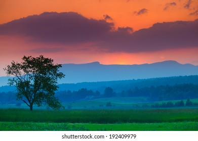 Colorful sunset and clouds over Mt. Mansfield in Stowe Vermont, USA