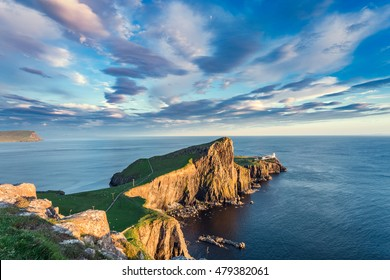 Colorful Sunset Clouds over Neist Point Lighthouse, Popular Location on the Isle of Skye in Scotland
