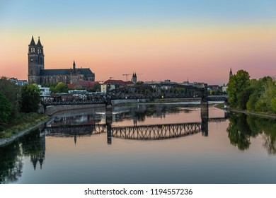 Colorful sunset in front of cathedral and old bridge in Magdeburg, Germany, Autumn
