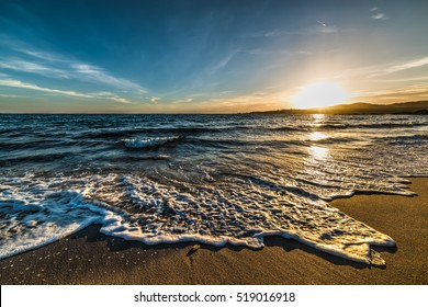 Colorful sunset in Le Bombarde beach, Sardinia