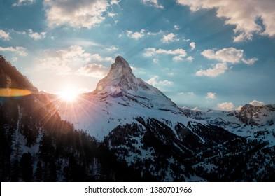 Colorful sunset at the Matterhorn in Zermatt Switzerland, view from the village of findeln high above Zermatt.