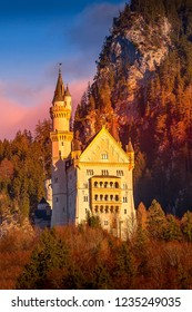 Colorful sunset Neuschwanstein Castle in Germany located in Fussen, Bavaria with pink and blue sky