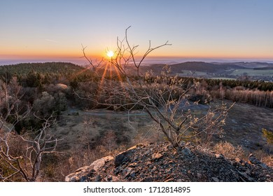 Colorful sunset in the old quarry  in the Orlické Mountains, Czechia - Shutterstock ID 1712814895