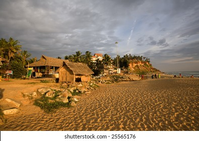 Colorful sunset on the beach in the Kerala over orange sand