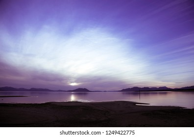 Colorful sunset on Gustavus beach in Southeast Alaska at low tide.