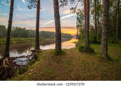 colorful sunset on river Gauja in Latvia, summer colors, rivers in forest with mist