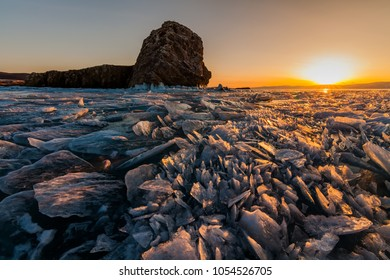Colorful sunset over the crystal ice of Baikal lake.