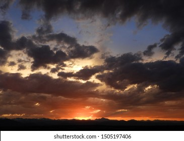 colorful sunset over long's peak, mount audobon, sawtooth mountain. and the front range of the colorado rocky mountains as seen from  broomfield, colorado