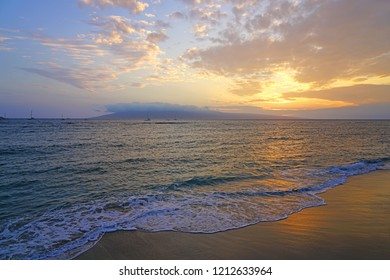 Colorful sunset over the ocean with the island of Lanai in the background seen from Lahaina, Maui, Hawaii