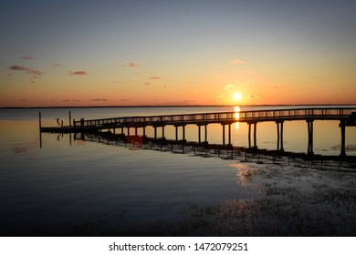 Colorful Sunset over a Pier in Duck, NC