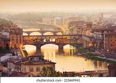 Colorful sunset over Ponte Vecchio on Arno River, Florence, Italy