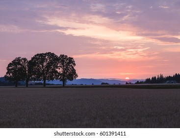 Colorful sunset over a rural farming landscape in Oregon, USA.