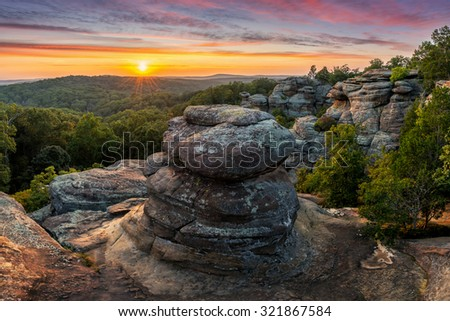 A colorful sunset over the sandstone hoodoo's at Shawnee National Forest's Garden of the Gods.