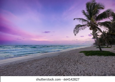 Colorful sunset over Tulum beach, Mexico