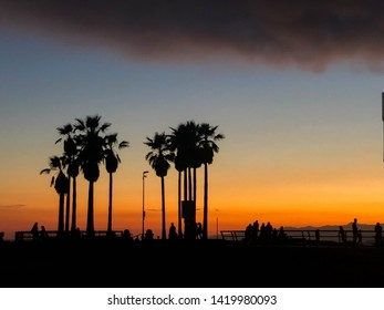 Colorful sunset over Venice beach, CA with marine layer