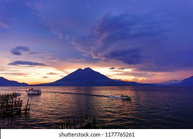 A colorful sunset overlooking the volcano at the Atitlán lake in Sololá, Guatemala.