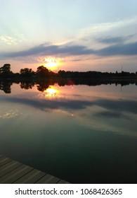 Colorful sunset reflected on lake