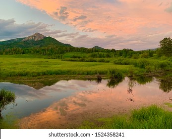 Colorful sunset reflection of mountain peak