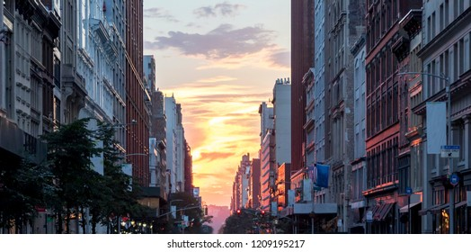 Colorful sunset sky between the buildings of Midtown Manhattan in New York City NYC