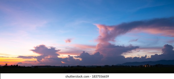 Colorful sunset and sunrise with clouds. Blue and orange color of nature. Many white clouds in the blue sky. The weather is clear today. sunset in the clouds. The sky is twilight.