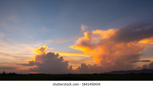 Colorful sunset and sunrise with clouds.Blue and orange color of nature.Many white clouds in the blue sky.The weather is clear today.sunset in the clouds.The sky is twilight.
