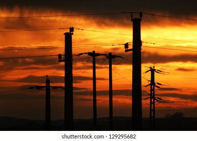 Colorful sunset urban power lines