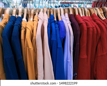 colorful sweatshirt on the rack