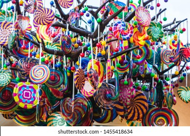 A lot of colorful sweet lollipops. Soft focus.