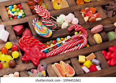 Colorful sweets box. Lollipops, macaroons, marshmallow, marmalade and candies