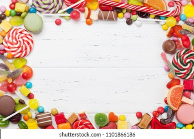 Colorful sweets. Lollipops and candies. Top view with space for your greetings