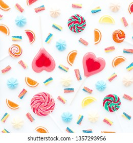 Colorful sweets on white background, flat lay, top view