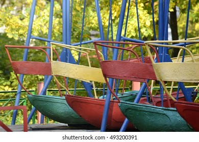 colorful swing boats at rest in the autumn park