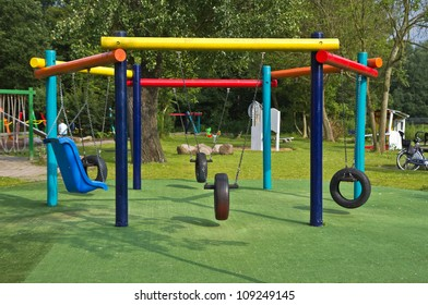 Colorful swings at playground in public park