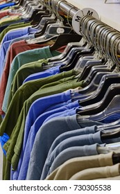 Colorful T Shirts on store rack Showing Size Medium