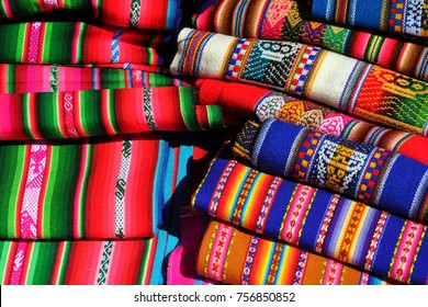 Colorful table cloths for sale in a traditional market near Cusco in Peru