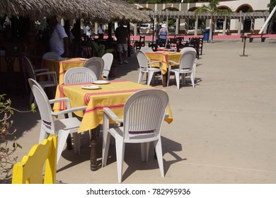 Colorful tables and chairs at beach restaurant in Huatulco, Mexico