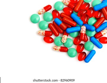 Colorful tablets with capsules isolated on white background