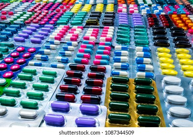 Colorful of tablets and capsules pill in blister packaging arranged with beautiful pattern. Pharmaceutical industry concept. Pharmacy drugstore. Defective and error in pharmaceutical factory concept.