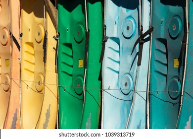 Colorful Tandem Two-Person Kayaks Lined Up in the Sunlight