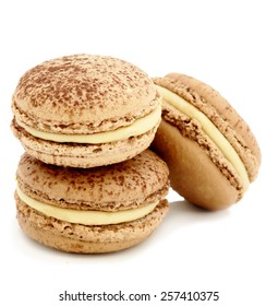 colorful and tasty macaroons over white background
