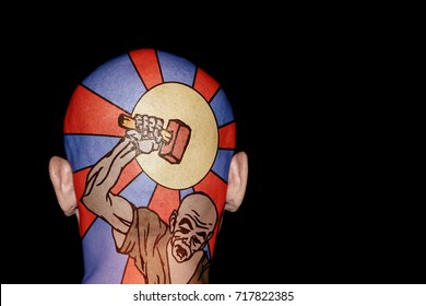 A colorful tattoo of a slave wielding a hammer on the back of a skinhead head.