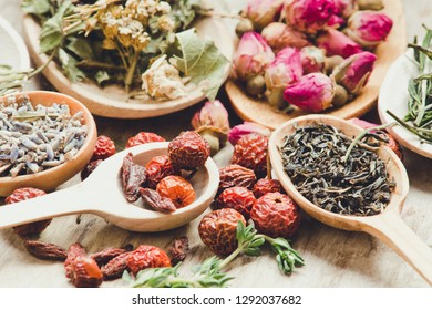 Colorful tea in wooden spoon/toned photo
