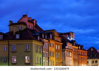 Colorful tenement houses at night in Old Town of Warsaw city in Poland