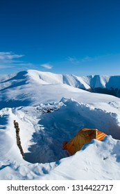 Colorful tent in high snowy mountains, (Refuge du Goater) halfway up in Carpathian mountain - Image
